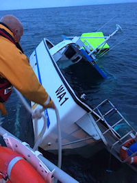Barrow RNLI rescue three men from sinking fishing vessel